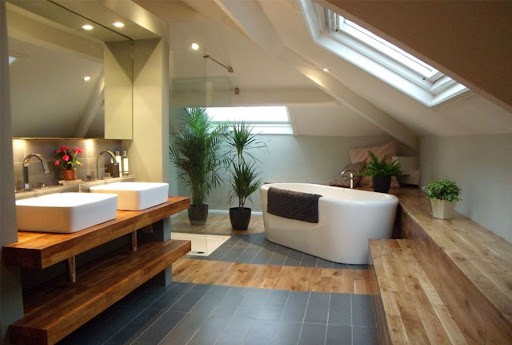 small bathroom with a beautiful floor and sloped ceiling design