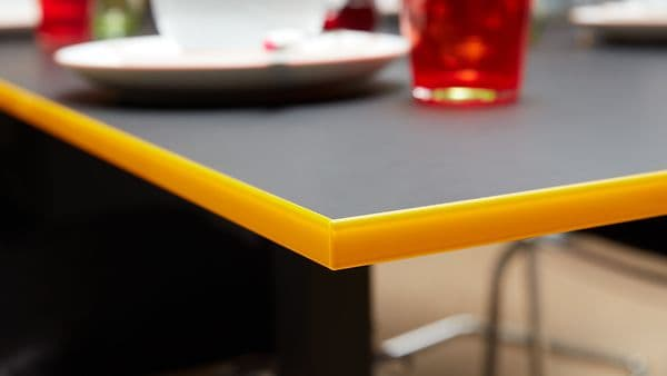 black table with yellow furniture fittings